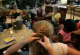 (1/28/05, Chennai, India) Kaylin Shaw has her French braided for the ride home by her ...
