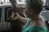 (1/28/05, Chennai, India)  Radha George shakes hands with Deb Lake from Michigan as the medical...