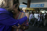 (1/28/05, Chennai, India) Radha George, Samson George's wife, cries in the arms of her great...