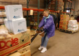 (DENVER Colo., January  28, 2005)  Shirley Hendrick pulls a pallet of food she collected for the...