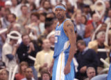 Minneapolis, Minn., Photo taken April 30, 2004- Nuggets center, Marcus Camby, watches the Nuggets...