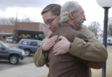 (LAMAR, Colo, January 31, 2005) Mark Headlee(left) hugs his father Don Headlee, (rt) outside of...