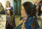(DENVER, Colo., February 13, 2005) Samantha Ginsburg,16, reacts as ten inches of her hair is cut...