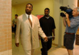 Former Denver Broncos linebacker John Mobley leaves a Douglas County, Colo., courtroom with...