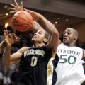 FLLA106 - Wake Forest's Chris Ellis (0) prepares to past the ball as Miami's Anthony King (50)...