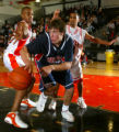 (Aurora, Colo., February 1, 2005) Heritage's Will Marshall (21, blue, center) gets a rebound and...