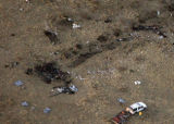 PUEBLO, COLO.-February 17,2005- Debris lays scattered in a field where Cessna Citation jet crashed...