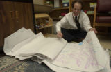 (FORT CARSON, Colo., February 1, 2005) Doug Lehman, sorts through pages of children's artworks...