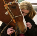 FOR STOCK SHOW - Brittney Holland (cq), 14, of Aledo communes with Tee, her horse, Friday morning,...