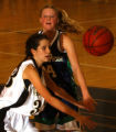 Littleton, Colo., photo taken Feb.3, 2005- ThunderRidge's Emily Fox (right) knocks the ball loose...