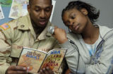 (FORT CARSON, Colo., February 1, 2005) Sgt. Jeffery Smith reads with his daughter, Corle,13, (cq...