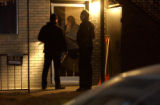 (Denver, COLO.  February 18, 2005) Denver Police search a house on Marion St. near 11th Ave. in...
