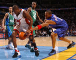 enver, Colo., photo taken February 18, 2005- Miami's Dwyane Wade (left) gets the ball swipped away...