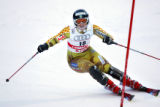 (SANTA CATERINA, Italy - Shot 2/4/2005) Anja Paerson (#18) of Sweden works her way around a set of...
