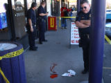 Denver, Colo., photo taken Feb. 4, 2005- Denver police investigate a nonfatal stabbing in front of...