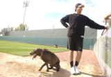 [(Tucson, AZ, Shot on: 2/16/05)] Colorado Rockies first baseman Todd Helton hangs out with his dog...
