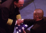 (AURORA, Colo., February 18, 2005) Aurora FIre Department Chief Casey Jones presents a flag to...