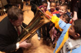 (Denver, Colo., February 7, 2005) Pete Vriesenga, of Golden, left, plays the tuba while a group of...