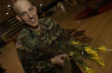 (FORT CARSON, Colo., February 8, 2005) Sspecialist Jacob Wilson had flower duty before th soldiers...