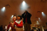 (Denver, CO., February 9, 2005) (FOREGROUND) Denver Buddhist Cultural Society members David Wang,...