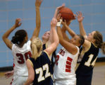(AURORA, Colo., February 25, 2005)  Eaglecrest's Brooklynn Fields (42), second from right, grabs a...