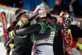 (BORMIO, Italy - Shot 2/13/2005) German team members hug one another in the finish area after...