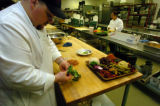 (DENVER, Colo., February 14, 2005)  Joe Beggs, executive chef, left, and Olga Sales, background,...