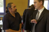 Ricardo Martinez, left with blue shirt,  founder of Padres Unidos (from reporter) talks with...