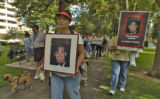 Sandra Smith (cq) carries a sign of her late brother Jay Quintana (cq), during 18th Annual AIDS...