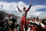 Dan Wheldon (#26), celebrates after winning the Honda Indy 225 IRL IndyCar Series Race at Pikes...