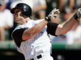 DXF108 - Colorado Rockies' Matt Holliday follows the flight of his two-run home run on a pitch...