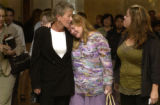 L to R: Colleen Auerbach, mother of Lisl Auman , hugs family friend Kathy Sparks (cq) outside of ...