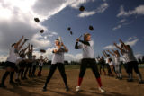 Pomona High School softball players Jr. Ashli Holland, cq, 16, left, and Sr. Jenn Brock, cq, 17,...