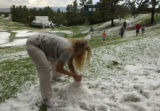 (Castle Rock, Colo., August 3, 2004) Sue Nakagawa, of Denver, makes a snowman out of hail at the...