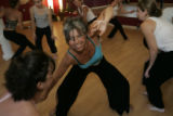 Brook Shannon, cq, center, Denver,participates in a Nia class at Studio Soma in North Denver on...