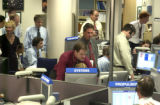 Members of Mission Control at Lockheed Martin Space Systems during  the successful launch of the...