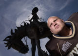 Dusty Hoffschneider poses with a statue in  War Memorial Stadium during the University of Wyoming...