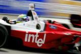 Justin Wilson (#9) of the Intel - RuSPORT team races around Turn 1 during Champ Car qualifying...