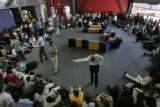 Faculty members at the Denver School of Science and Technology get students organized into a...