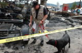 (FRISCO, Colo., Aug 5, 2004)  Jerry Means and his arson dog Erin, of the Colorado Bureau of...