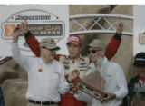 Sabastien Bourdais (center) celebrates his win in the Champ Car race at the CENTRIX Financial...