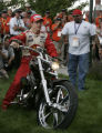 JPM0016 - Newman/Haas Racing driver Sebastien Bourdais, of France, left, drives a motorcylce into...