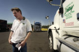 Semi-Truck driver Kevin Calvert (CQ), 35, of Ft. Worth Texas holds his 400-dollar fuel bill at the...