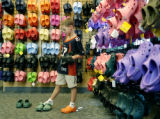 Denver, CO Aug. 15, 2005 Wyatt Dessel, 7, of Boulder, trys to decided what collor Crocs he wants...