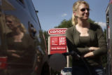 Krista Henderson (CQ), of Denver fueled-up her Cadillac Escalade with $3.149 super unleaded gas...