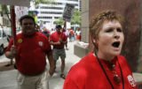 Qwest Communications load specialist Jackie Haigh, cq, right, leads a pro-union chant as she,...