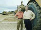 Denver, CO Aug. 16, 2005 Tim Wiens (left) and John Frew stand at the construction site of the...