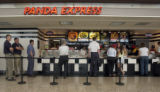 Travelers line up at a fast food restaurant at DIA Tuesday, August 16,  2005.  There has ben a...
