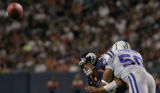 Denver Broncos quarterback Jake Plummer takes a hit from  Indianapolis Colts linebacker David...