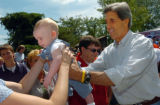 (8/06/2004, GOLDEN, CO)    John Kerry passes  baby Jett McHenry back to his mom Carmen McHenry...
